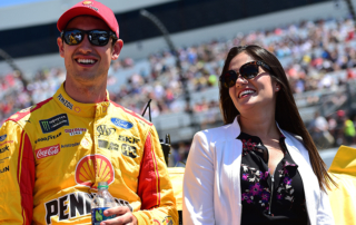 RICHMOND, VA - APRIL 30:  Joey Logano, driver of the #22 Shell Pennzoil Ford, and his wife Brittany stand on the grid prior to the Monster Energy NASCAR Cup Series Toyota Owners 400 at Richmond International Raceway on April 30, 2017 in Richmond, Virginia.  (Photo by Jared C. Tilton/Getty Images)
