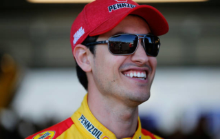 PHOENIX, AZ - NOVEMBER 09:  Joey Logano, driver of the #22 Shell Pennzoil Ford, stands in the garage area during practice for the Monster Energy NASCAR Cup Series Can-Am 500 at ISM Raceway on November 9, 2018 in Phoenix, Arizona.  (Photo by Jonathan Ferrey/Getty Images)